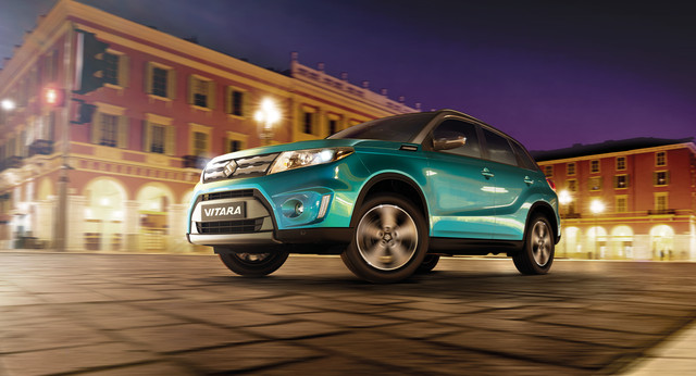 Suzuki Vitara in Turquoise in City at Night